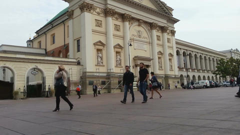 Crowd of people walking across the square, tourists sightseeing in European city Footage