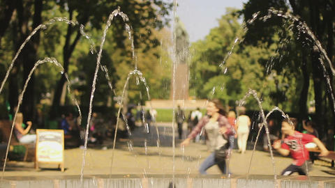 Many people walking, enjoying summer festival. Children running in central park Footage