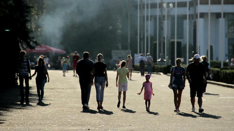 Silhouettes of people walking in park. Street food festival at exhibition center Footage