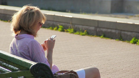 Lady reading message on smartphone with smile on her face, browsing internet Footage