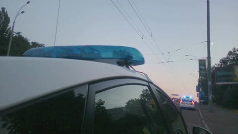 Blue twirling lights of police car, city road accident, crime scene, emergency Footage