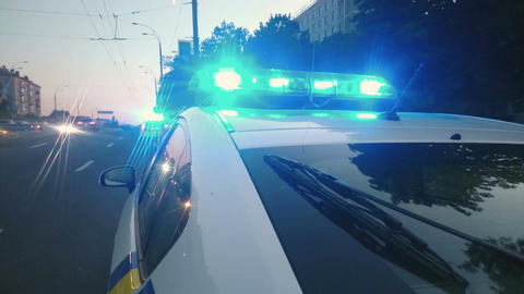Police car LED strobe lightbar, flashing blue lights, emergency vehicle lighting Footage