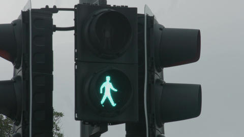 Red traffic light changes to green, allows pedestrians walk. Grant permission Footage