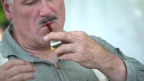 Civil War soldier lighting tobacco pipe Footage