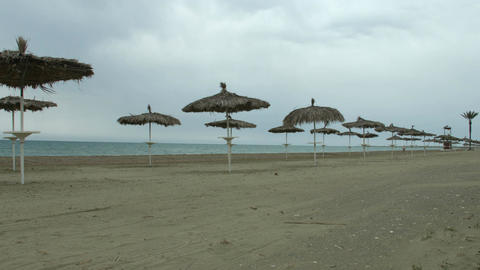 Empty seaside beach. Cold weather at popular summer resort during low season Footage