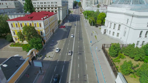 Aerial View of Bustling Traffic on The Road at Crossroads in Sunny Day Footage
