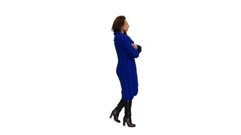 An elegant woman in dark blue cardigan is walking, 4k shot with alpha channel Footage