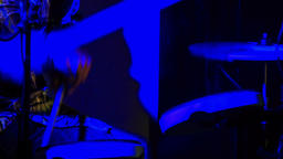 Closeup Drummer Plays Drum Plates in Night Bar under Flashes Live Action