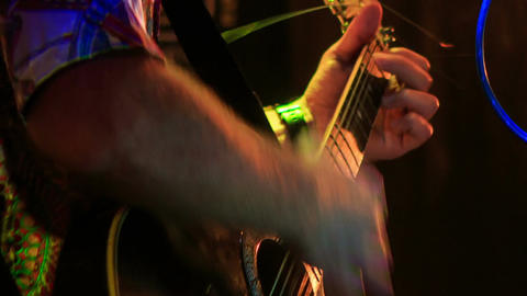 Guitarist Plays Guitar in Night Club against Light Flashes Footage