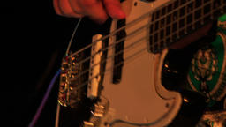 Closeup Guitarist Touches Electric Guitar Strings in Night Bar Footage