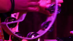 Closeup Hands Play Tambourine in Night Bar under Flashes Footage