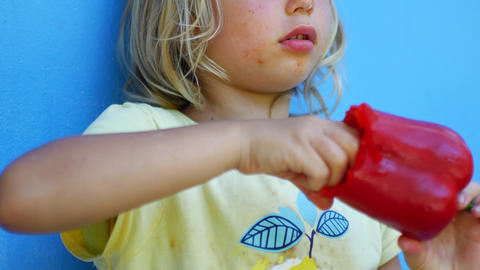 A child eats whole raw paprika Live Action