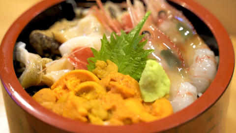 A bowl of a traditional Japanese raw fish on rice dish Kaisendon at a high-end sushi restaurant Live Action