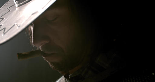Cowboy in dramatic lighting, standing with a cigar in his mouth, profile, 4k Live Action