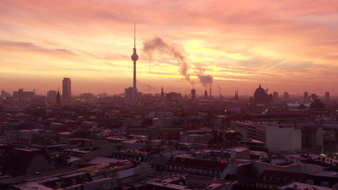 AERIAL: Beautiful View of Berlin TV Tower Alexanderplatz with with smoke on Live Action