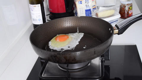 SLOW MOTION: Fried Egg , Egg Sunny side up getting cooked in Pan , cooking egg Live Action