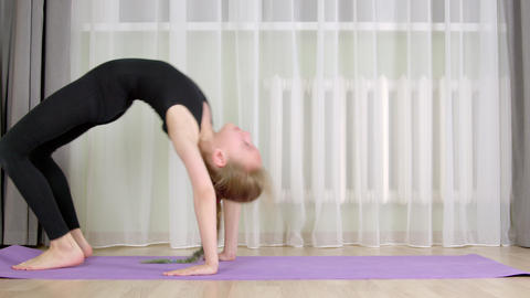 Cute young girl training at home Live Action