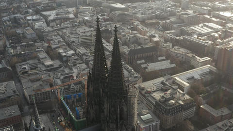 AERIAL: Close Up circling around Cologne Cathedral in beautiful hazy Sunlight Live Action