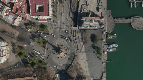 AERIAL: Overhead Shot of Columbus Monument Roundabout in Barcelona, Spain with Live Action