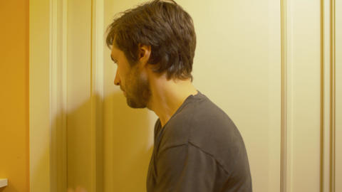 The couple quarrels, husband pushes at the door Live Action