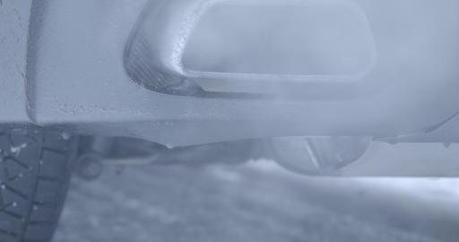 Extreme close-up of car exhaust pipe with smoke emission. Modern transport Live Action