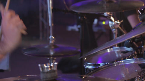 Slow motion of a drummer plays drums kit with the drumstick on the drum plate Live Action