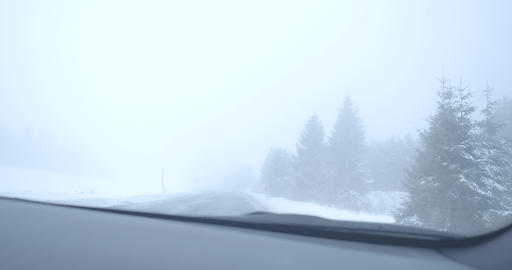 Driver's point of view, foggy winter road on cold snowy day outdoors. Car riding Live Action