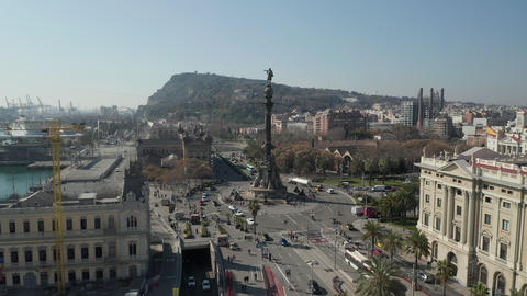 AERIAL: Slow Flight towards Columbus Monument in Barcelona, Spain with Palm Live Action