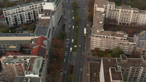 AERIAL: View of typical german street traffic with Bus public transportation and Live Action