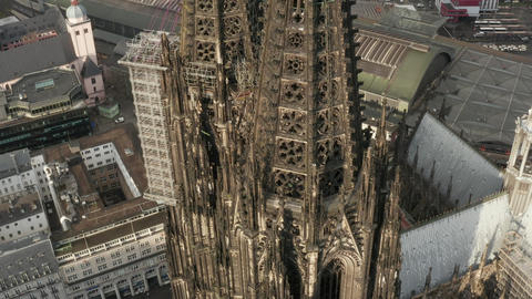 AERIAL: Close Up Circle around Cologne Cathedral brown Towers in beautiful Live Action