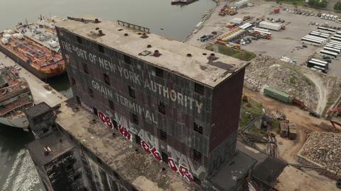 AERIAL: Twoards Rusty old Cargo Warehouse in the Docks of New York City on a Live Action