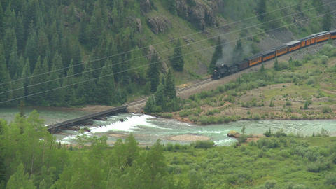 High angle of a steam train traveling through a ca Stock Video Footage