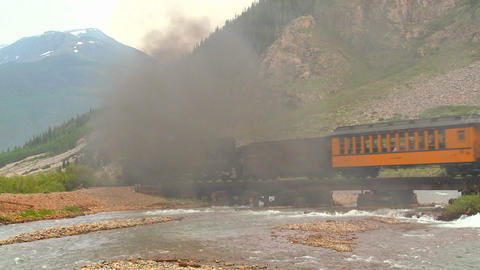 A beautiful shot of a steam train crossing a bridg Stock Video Footage