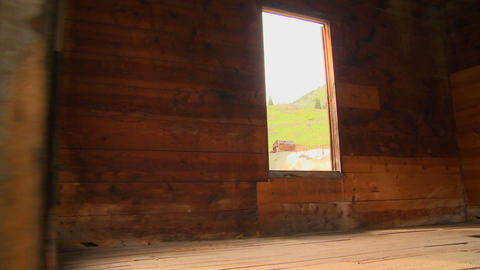 A traveling shot moves into an abandoned house in  Footage