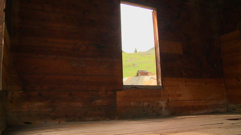 A traveling shot moves into an abandoned house in Stock Video Footage