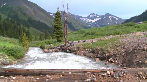 Rocky Mountain river and mountains, from a bridge Stock Video Footage