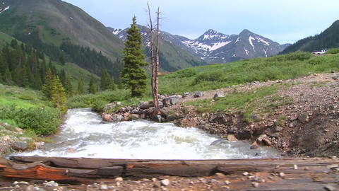 Rocky Mountain river and mountains, from a bridge Footage