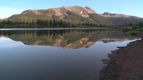 The Rocky Mountains are perfectly reflected in an  Footage