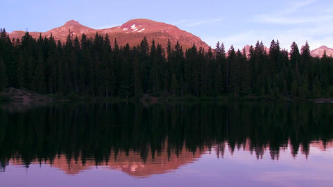 The Rocky Mountains are perfectly reflected in an Stock Video Footage