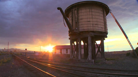 A water towers along an abandoned railroad track a Stock Video Footage