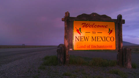 A roadside sign welcomes visitors to New Mexico as Stock Video Footage