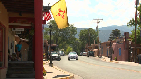 The New Mexico flag flies on a street in Taos, New Footage