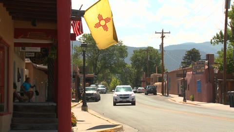 The New Mexico flag flies on a street in Taos, New Stock Video Footage