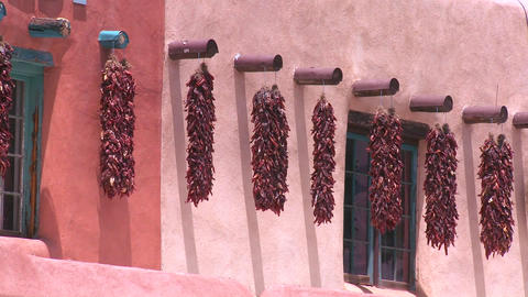 Chili peppers hang outside a New Mexico building Stock Video Footage