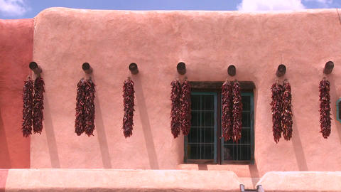 Chili peppers hang outside a New Mexico building i Stock Video Footage