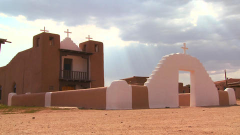 An old adobe church stands at the Taos pueblo in N Stock Video Footage