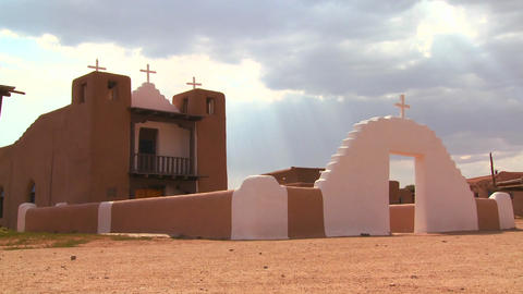 An old adobe church stands at the Taos pueblo in N Footage
