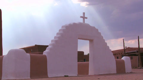 A Christian cross glows against a heavenly sky at  Footage