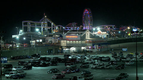A night shot of the Santa Monica pier in Los Angel Stock Video Footage
