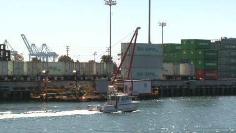 A harbor boat passes beside Long Beach harbor and Stock Video Footage